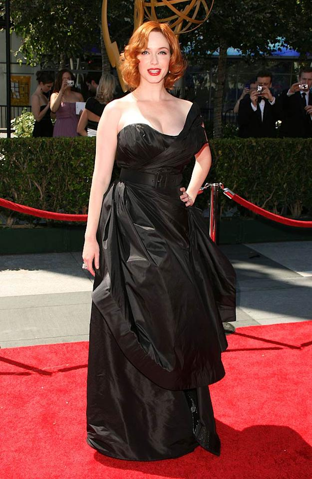 """Christina Hendricks -- who is nominated for Best Supporting Actress in a Drama for her wonderful work on """"Mad Men"""" -- made a dramatic entrance at last weekend's Creative Arts Emmy Awards thanks to her beautifully belted Christian Siriano gown, signature red lips, and fiery head of red. Amanda Leddy/<a href=""""http://www.splashnewsonline.com"""" target=""""new"""">Splash News</a> - August 21, 2010"""