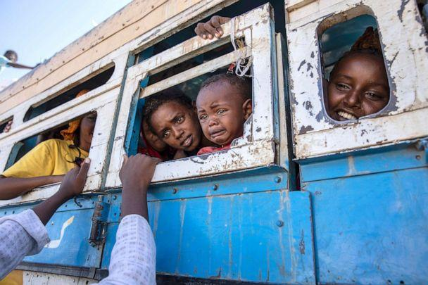 PHOTO: Tigray refugees who fled the conflict in the Ethiopia's Tigray region ride a bus going to a temporary shelter near the Sudan-Ethiopia border, in Hamdayet, eastern Sudan, Dec. 1, 2020. (Nariman El-mofty/AP)