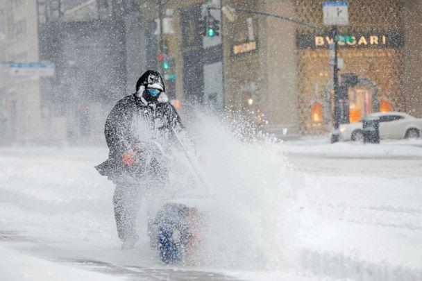 PHOTO: A worker clears a street during a snow storm in the Manhattan, Feb. 1, 2021. (Andrew Kelly/Reuters)
