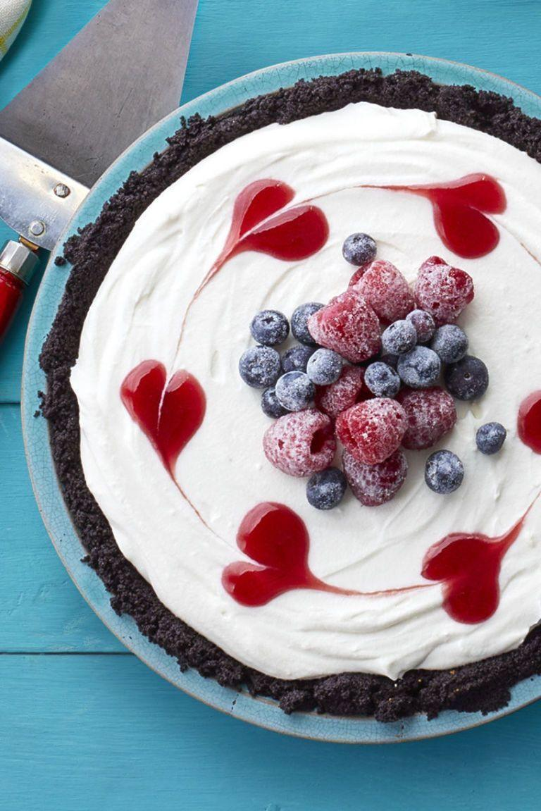 """<p>Top this sweet berry-filled pie with some sugared berries to make it look like something you bought at the fanciest of bakeries. Your family will be so impressed. </p><p><strong><em><a href=""""https://www.womansday.com/food-recipes/food-drinks/recipes/a58996/coconut-cream-raspberry-jam-pie-recipe/"""" rel=""""nofollow noopener"""" target=""""_blank"""" data-ylk=""""slk:Get the Coconut Cream and Raspberry Jam Pie recipe."""" class=""""link rapid-noclick-resp"""">Get the Coconut Cream and Raspberry Jam Pie recipe. </a></em></strong></p>"""