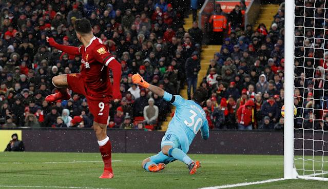 "Soccer Football - Premier League - Liverpool vs Watford - Anfield, Liverpool, Britain - March 17, 2018 Liverpool's Roberto Firmino scores their third goal REUTERS/Phil Noble EDITORIAL USE ONLY. No use with unauthorized audio, video, data, fixture lists, club/league logos or ""live"" services. Online in-match use limited to 75 images, no video emulation. No use in betting, games or single club/league/player publications. Please contact your account representative for further details."