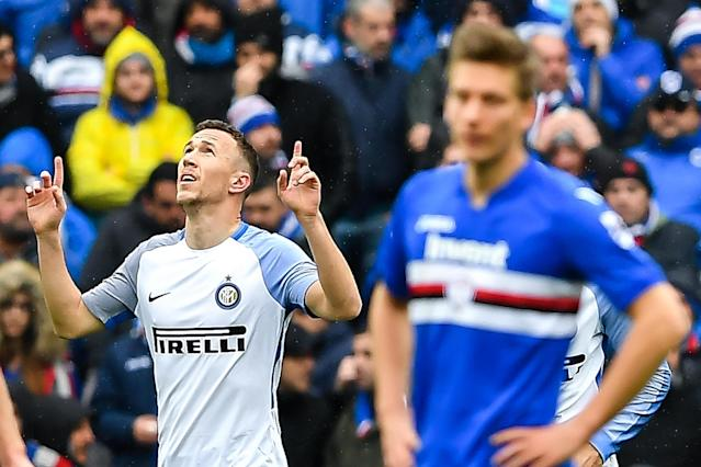 Inter's midfielder Ivan Perisic, left, celebrates after scoring during the Italian Serie A soccer match between Sampdoria and Inter at the Luigi Ferraris Stadium in Genoa, Italy, Sunday, March 18, 2018. (Simone Avreda/ANSA via AP)