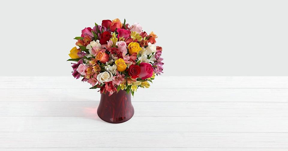 """<p>Brighten up your loved one's day with the <a href=""""https://www.popsugar.com/buy/Premium-Smiles-Sunshine-444289?p_name=Premium%20Smiles%20and%20Sunshine&retailer=proflowers.com&pid=444289&price=77&evar1=casa%3Aus&evar9=46127505&evar98=https%3A%2F%2Fwww.popsugar.com%2Fhome%2Fphoto-gallery%2F46127505%2Fimage%2F46128467%2FPremium-Smiles-Sunshine&list1=shopping%2Cgift%20guide%2Cflowers%2Chouse%20plants%2Cplants%2Cmothers%20day%2Cgifts%20for%20women&prop13=api&pdata=1"""" class=""""link rapid-noclick-resp"""" rel=""""nofollow noopener"""" target=""""_blank"""" data-ylk=""""slk:Premium Smiles and Sunshine"""">Premium Smiles and Sunshine</a> ($77) bouquet. </p>"""