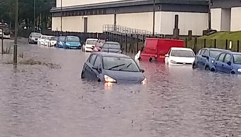 Rain storms and flooding course chaos around Edinburgh as cars and buses are almost drowned by the torrential downpour and rising waters. June 24 2019.