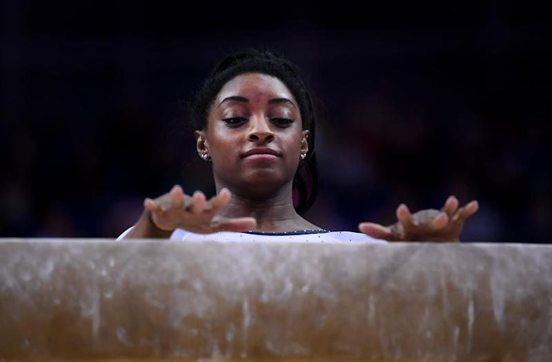 LONDON, ENGLAND - MARCH 23: Simone Biles of the USA performs on balance beam during the Superstars of Gymnastics at The O2 Arena on March 23, 2019 in London, England. (Photo by Laurence Griffiths/Getty Images)