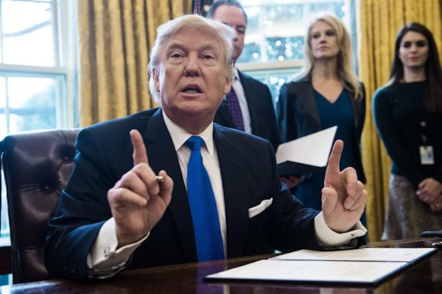President Donald Trump signed an executive action in January meant to spur the construction of the Keystone XL and Dakota Access pipelines. (NICHOLAS KAMM via Getty Images)