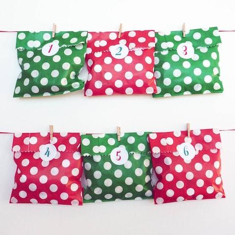 Little Cherub Design Spotty Advent Bags And Stickers from Not On The High Street - Credit: Not On The High Street