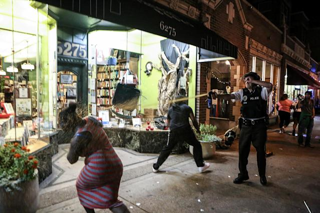 <p>A protester is sprayed with mace by riot police after throwing a chair through a window of a business during the second night of demonstrations after a not guilty verdict in the murder trial of former St. Louis police officer Jason Stockley, charged with the 2011 shooting of Anthony Lamar Smith, who was black, in St. Louis, Mo., Sept. 16, 2017. (Photo: Lawrence Bryant/Reuters) </p>