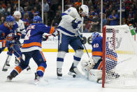 Tampa Bay Lightning left wing Pat Maroon (14) looks for the rebound on a shot blocked by New York Islanders goaltender Semyon Varlamov (40) during the third period of Game 6 of the NHL hockey Stanley Cup semifinals, Wednesday, June 23, 2021, in Uniondale, N.Y. (AP Photo/Frank Franklin II)