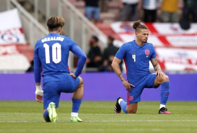 Kalvin Phillips, right, takes a knee in support of the fight against racism before England's friendly with Romania