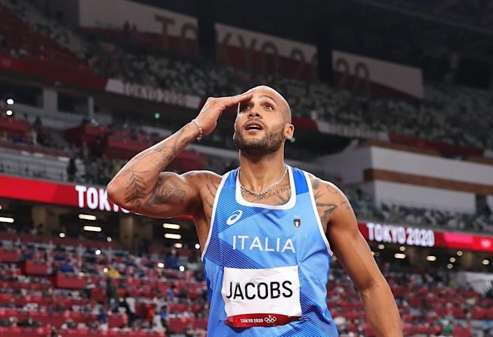 Lamont Marcell Jacobs appears in disbelief when he realizes he's won Olympic gold in the 100-meter final.