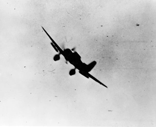 <p>A Japanese navy Type 99 Val carrier bomber is seen in action during the attack on Pearl Harbor on Dec. 7, 1941. (U.S. Navy/National Archives/Handout via Reuters) </p>