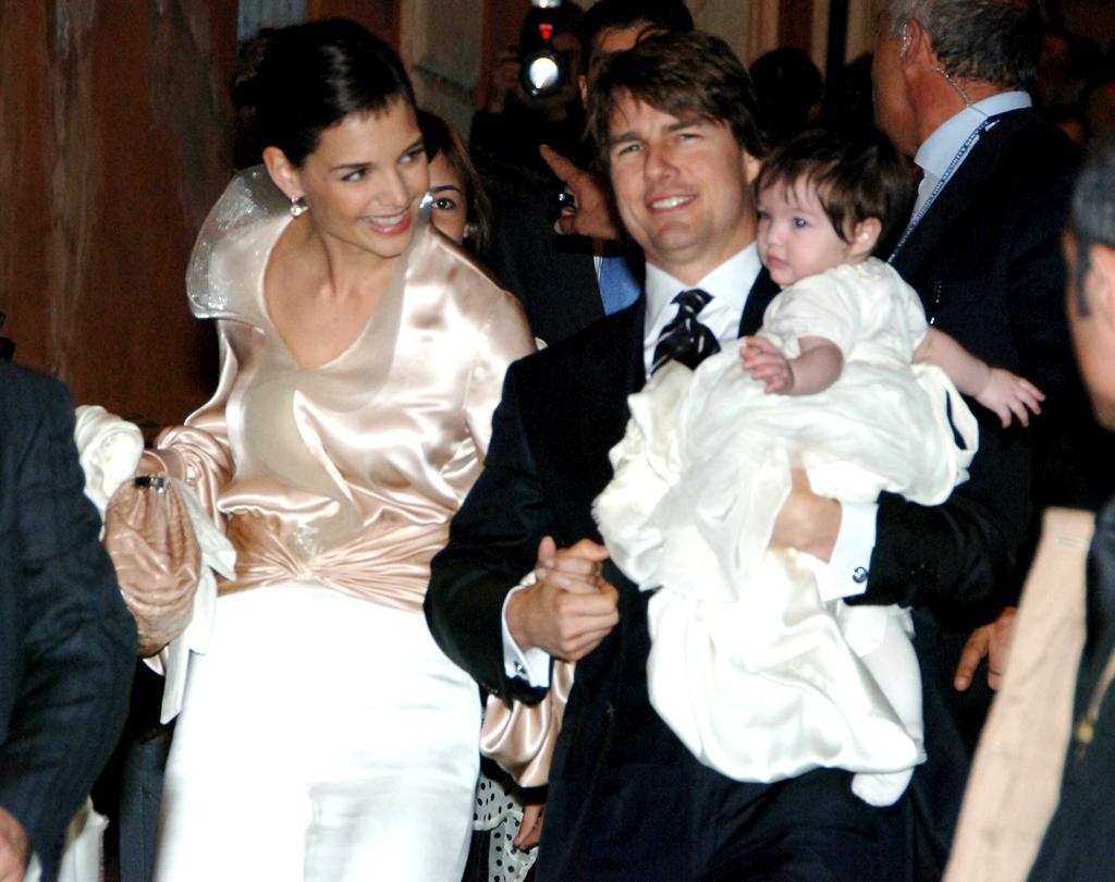 At just 7 months old, Suri wore a silk tulle gown by Giorgio Armani for a  pre-wedding dinner for her parents in Rome in November 2006.