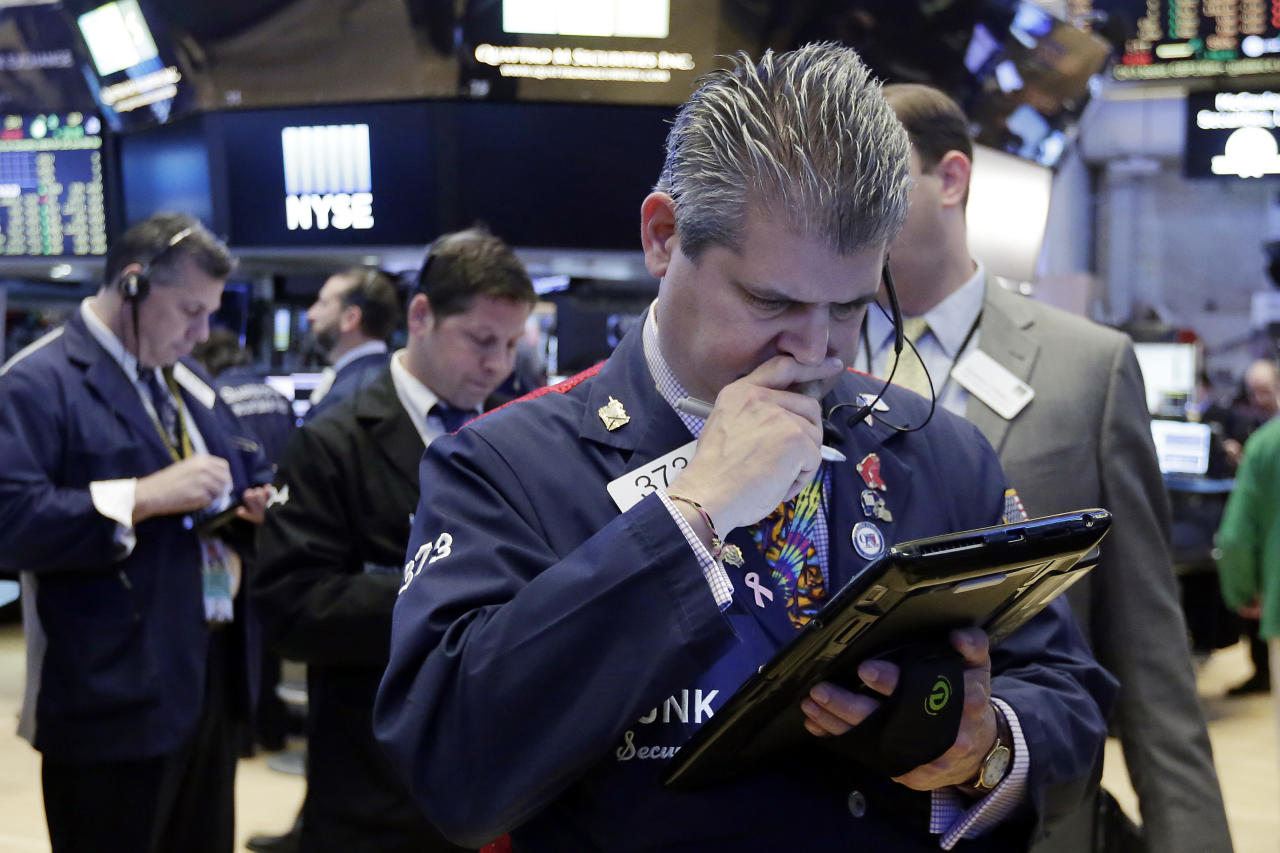 Trader John Panin, foreground, works on the floor of the New York Stock Exchange, Tuesday, May 23, 2017. Stocks are opening slightly higher on Wall Street as technology companies post more gains. (AP Photo/Richard Drew)