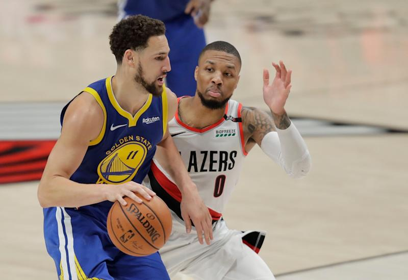 Golden State Warriors guard Klay Thompson (11) drives around Portland Trail Blazers guard Damian Lillard (0) during the second half of Game 3 of the NBA basketball playoffs Western Conference finals against the Portland Trail Blazers, Saturday, May 18, 2019, in Portland, Ore. The Warriors won 110-99. (AP Photo/Ted S. Warren)