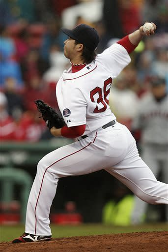 Boston Red Sox relief pitcher Junichi Tazawa, of Japan, delivers against the Cleveland Indians during the eighth inning of a baseball game at Fenway Park in Boston, Saturday, May 25, 2013. (AP Photo/Winslow Townson)