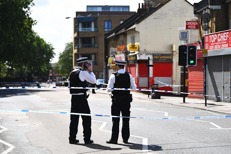 Police chiefs called for the government to invest in new officers after a spate of recent stabbings in London. Pictured: Police attend a stabbing in Stratford, east London. (PA)