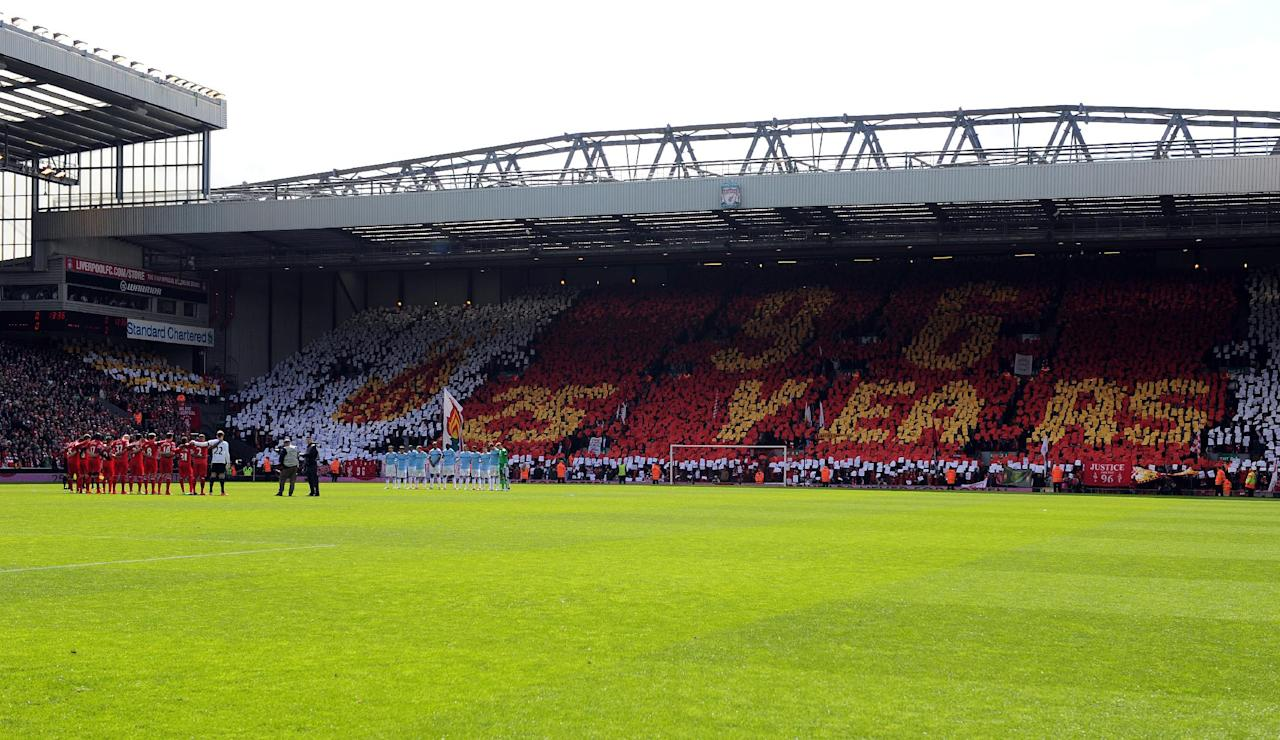 A minutes silence is observed prior to kick off to mark the 25th anniversary of the Hillsborough disaster during the English Premier League soccer match between Liverpool and Manchester City at Anfield in Liverpool, England, Sunday, April. 13, 2014. (AP Photo/Clint Hughes)
