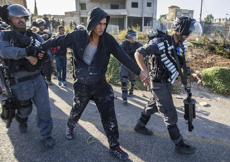 Israeli security forces detain an Arab-Israeli youth during clashes in the town of Kfar Kana, in northern Israel on November 9, 2014 (AFP Photo/Jack Guez)