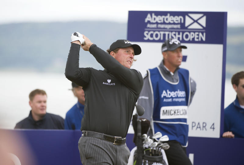 US golfer Phil Mickelson tees off at the 5th hole during day four of the Scottish Open golf championship at Castle Stuart Golf Course, Inverness Scotland Sunday July 14, 2013. (AP Photo/Kenny Smith/PA) UNITED KINGDOM OUT
