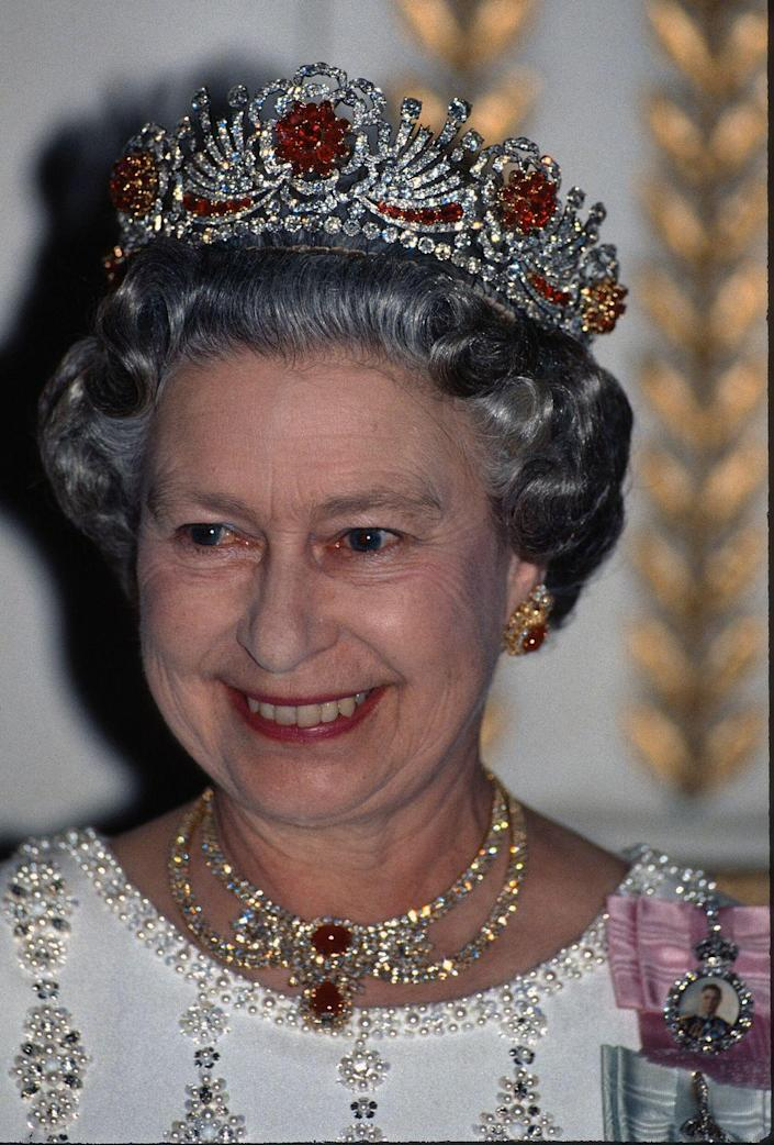 <p>In 1973, the Queen ordered this Burmese ruby tiara from Garrard. The tiara is set with 96 rubies that were given to the Queen from Burma as a wedding present. Here, she's wearing the tiara at a royal gala in 1977</p>