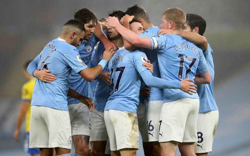 Man City players celebrate. - GETTY IMAGES