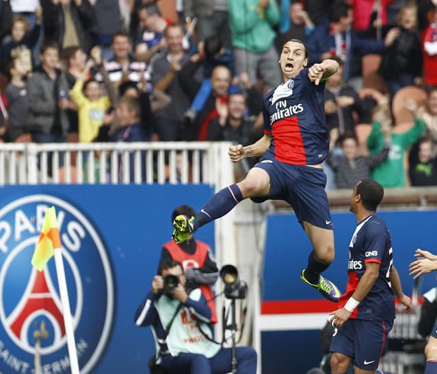 Paris Saint Germain's Zlatan Ibrahimovic jumps in the air after scoring the second goal against Bastia, during the French League One soccer match between Paris Saint Germain and Bastia, at the Parc des Princes stadium, in Paris, Saturday, Oct. 19, 2013.(AP Photo/Remy de la Mauviniere)
