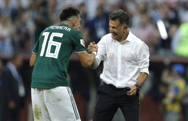 Mexico's Hector Herrera celebrates with manager Juan Carlos Osorio after El Tri's 1-0 World Cup win over Germany. (AP)