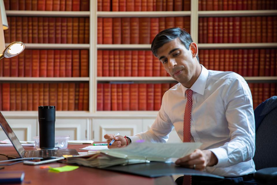 Undated handout photo issued by HM Treasury showing Chancellor of the Exchequer Rishi Sunak preparing the Economic Update he will present to Parliament tomorrow. (Photo: PA)