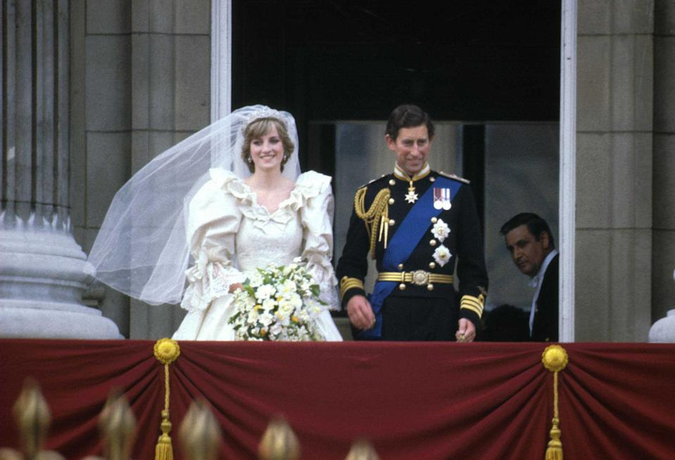Prince Charles & Princess Diana (1961 - 1997) stand on the balcony of Buckingham Palace after their wedding ceremony at St. Paul's Cathedral, London, England, July 29, 1981. (Photo by Express Newspapers/Getty Images)