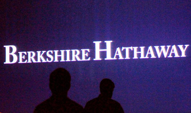 FILE PHOTO: File photo of Berkshire Hathaway shareholders walking by a video screen at the company's annual meeting in Omaha