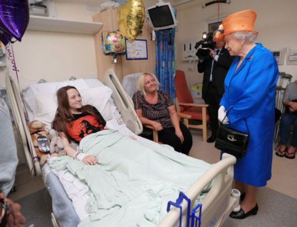 The Queen meets with victims of the Manchester Arena bombing. PA