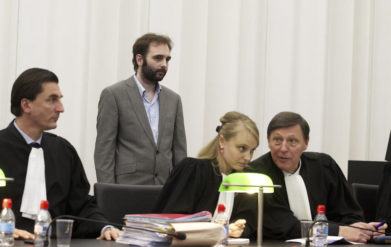 Child murderer Kim De Gelder , standing, hears the verdict on the last day of the trial in Ghent, Belgium, Friday, March 22, 2013. De Gelder claimed he was mentally ill when he entered a kindergarten in January 2009 and stabbed to death two babies and a woman. He also stabbed a 73-year-old woman to death in her house days earlier. The jurors found that there was ''not the least bit of doubt'' that he could be held accountable for his actions. He faces up to a life sentence in prison. (AP Photo/Nicolas Maeterlinck, pool)