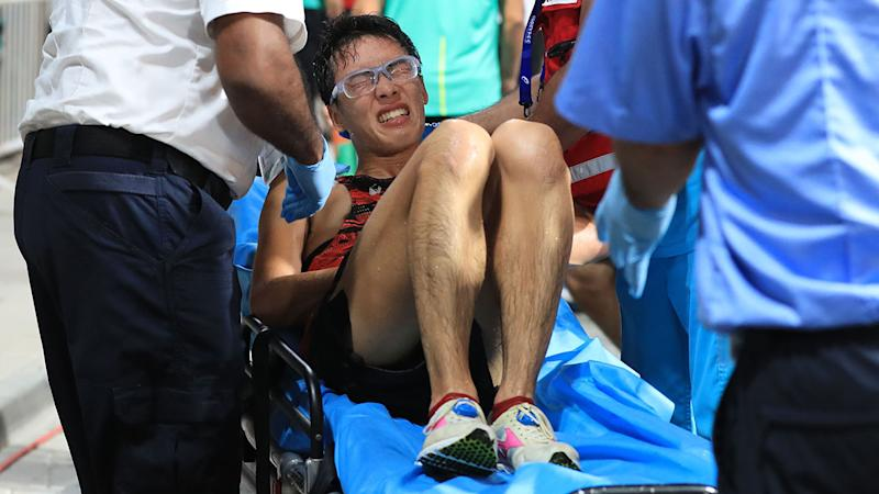 Japan's Tomohiro Noda, pictured here receiving medical attention.