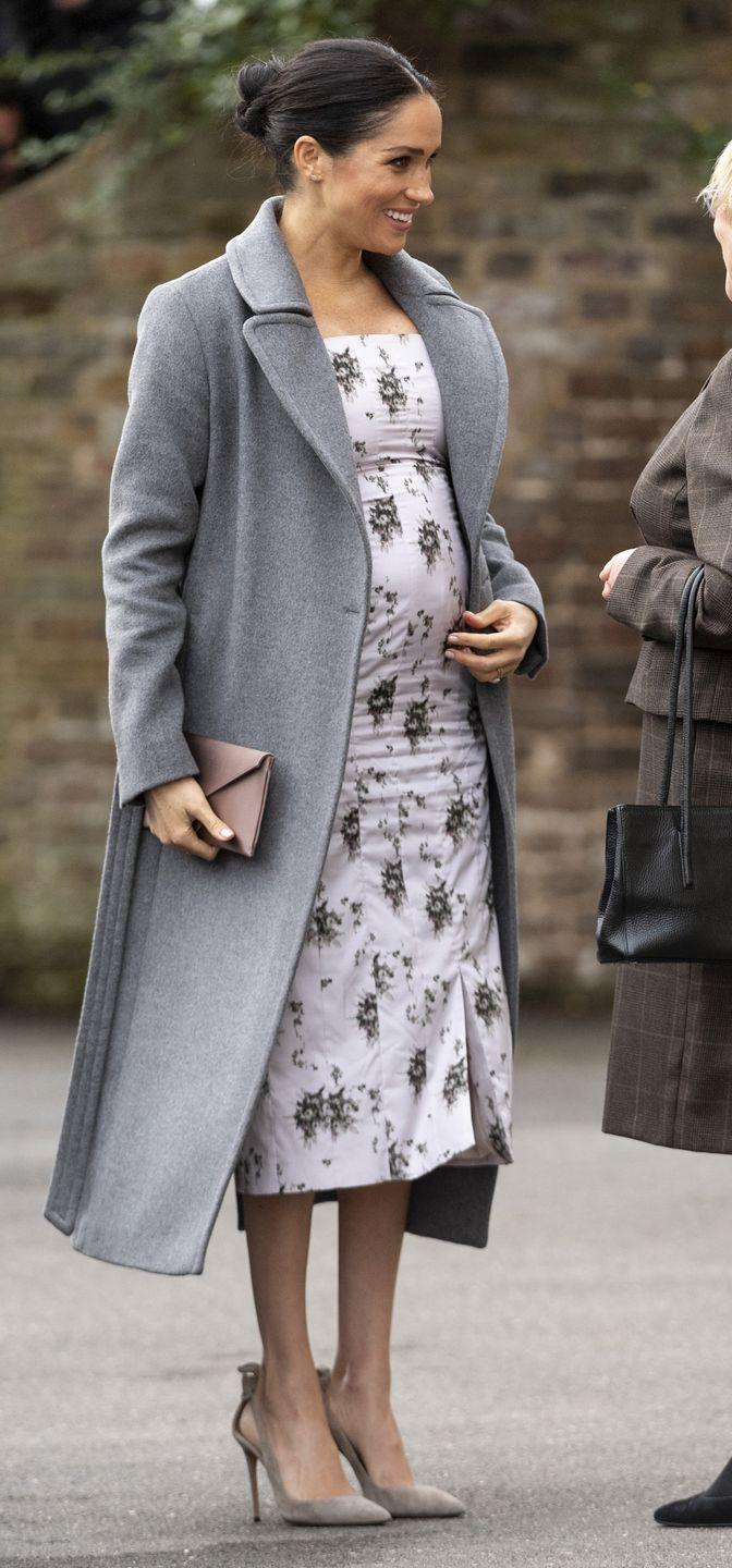 """<p>Meghan made a festive visit to Brinsworth House, the Royal Variety Charity's residential nursing and care home, wearing a floral dress by Brock Collection with a gray coat from <a href=""""https://go.redirectingat.com?id=74968X1596630&url=https%3A%2F%2Fwww.soiakyo.com%2Fus%2Fen%2Fadelaida-slim-fit-maxi-length-classic-wool-coat%2FADELAIDA.html&sref=https%3A%2F%2Fwww.townandcountrymag.com%2Fstyle%2Ffashion-trends%2Fg3272%2Fmeghan-markle-preppy-style%2F"""" rel=""""nofollow noopener"""" target=""""_blank"""" data-ylk=""""slk:Soia and Kyo"""" class=""""link rapid-noclick-resp"""">Soia and Kyo</a>, and a nude clutch and heels.</p>"""