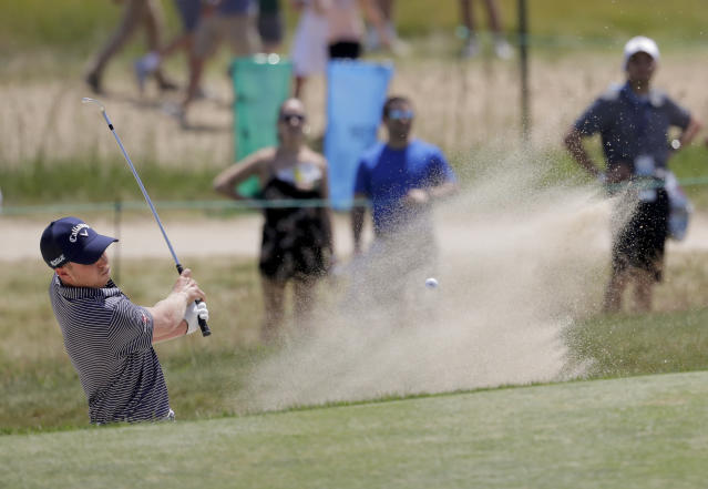 Daniel Berger plays a shot from a bunker on the 17th hole during the third round of the U.S. Open Golf Championship, Saturday, June 16, 2018, in Southampton, N.Y. (AP Photo/Julio Cortez)