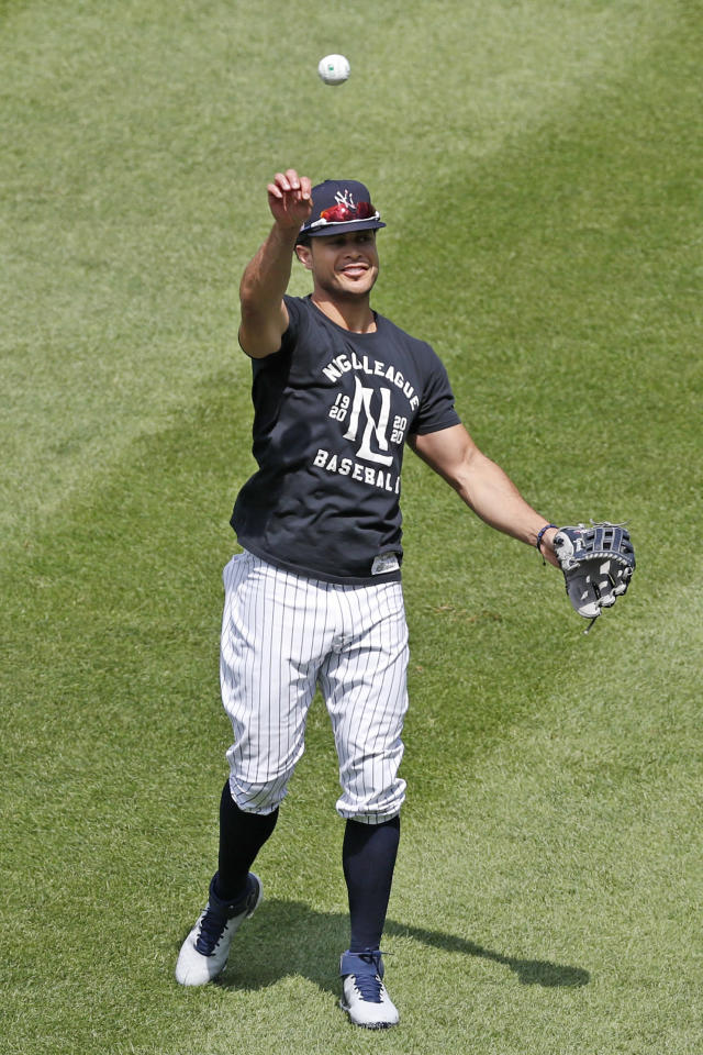 New York Yankees Giancarlo Stanton throws in the outfield during a workout at the Yankees summer baseball training camp, Wednesday, July 15, 2020, at Yankee Stadium in New York. (AP Photo/Kathy Willens)