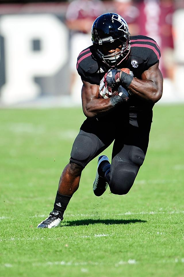 STARKVILLE, MS - NOVEMBER 03: Christine Michael #33 of the Texas A&M Aggies runs for yards against the Mississippi State Bulldogs at Wade Davis Stadium on November 3, 2012 in Starkville, Mississippi. (Photo by Stacy Revere/Getty Images)