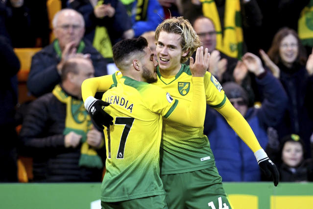 Norwich City's Todd Cantwell, right, celebrates scoring his side's first goal of the game during the English Premier League soccer match between Norwich and Wolverhampton Wanderers, at Carrow Road, in Norwich, England, Saturday Dec. 21, 2019. (Joe Giddens/PA via AP)