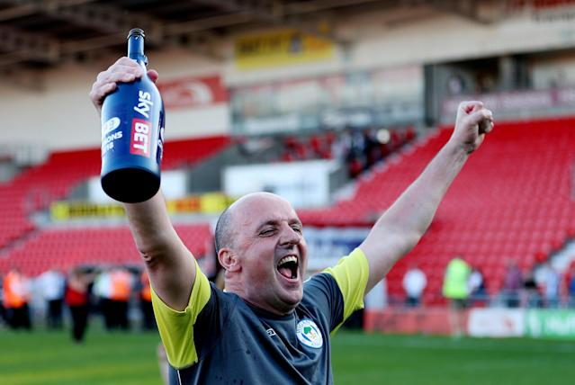 "Soccer Football - League One - Doncaster Rovers vs Wigan Athletic - Keepmoat Stadium, Doncaster, Britain - May 5, 2018 Wigan Athletic manager Paul Cook celebrates after winning League One Action Images/John Clifton EDITORIAL USE ONLY. No use with unauthorized audio, video, data, fixture lists, club/league logos or ""live"" services. Online in-match use limited to 75 images, no video emulation. No use in betting, games or single club/league/player publications. Please contact your account representative for further details."