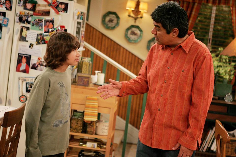 George Lopez speaks to Luis Armand Garcia in the family kitchen