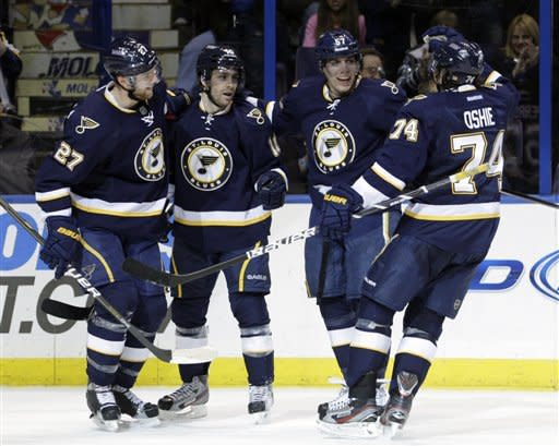 St. Louis Blues' David Perron, second from right, celebrates with teammates Alex Pietrangelo (27), Andy McDonald (10) and T.J. Oshie (74) after scoring a goal in the second period of an NHL hockey game against the St. Louis Blues on Sunday, Feb. 12, 2012, in St. Louis.(AP Photo/Tom Gannam)