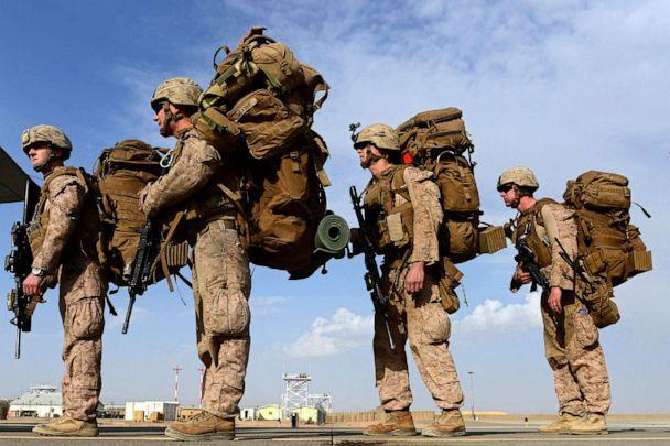 PHOTO: US Marines board a C-130J Super Hercules transport aircraft headed to Kandahar as British and US forces withdraw from the Camp Bastion-Leatherneck complex at Lashkar Gah in Helmand province, Afghanistan, Oct. 27, 2014. (Wakil Kohsar/AFP via Getty Images, FILE)