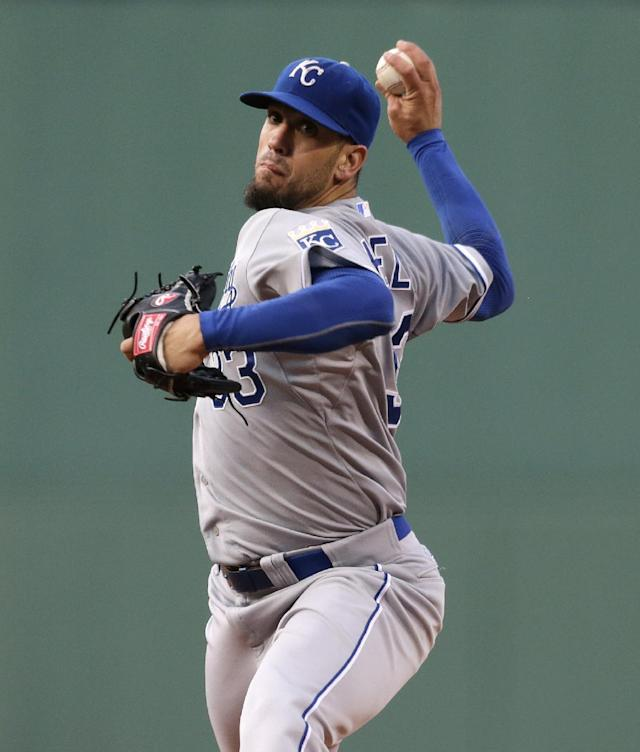 Kansas City Royals starting pitcher James Shields delivers to the Boston Red Sox during the first inning of a baseball game at Fenway Park in Boston, Friday, July 18, 2014. (AP Photo/Charles Krupa)