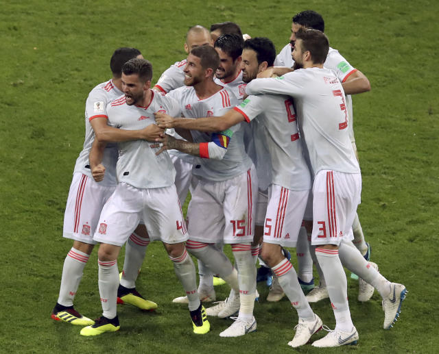 Spain's scorer Nacho, front left, and his teammates celebrate their side's 3rd goal during the group B match between Portugal and Spain at the 2018 soccer World Cup in the Fisht Stadium in Sochi, Russia, Friday, June 15, 2018. (AP Photo/Thanassis Stavrakis)