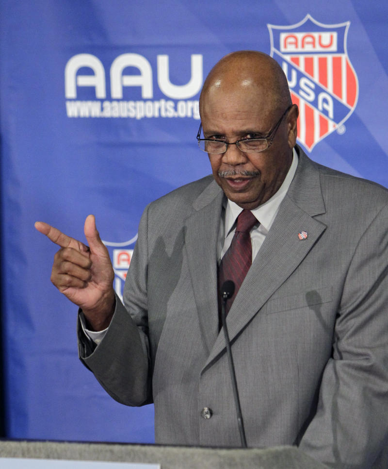 """Amateur Athletic Union president Louis Stout make comments during a news conference at AAU headquarters, Wednesday, Dec. 14, 2011, in Lake Buena Vista, Fla.  The Amateur Athletic Union announced Wednesday that two task forces established to independently review child safety protocols, policies and procedures will make their recommendations by February. The AAU announced the measures as a child sex abuse investigation dating back 30 years and centered on ex-president Robert """"Bobby"""" Dodd progresses in Tennessee.  (AP Photo/John Raoux)"""