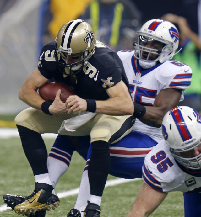 New Orleans Saints quarterback Drew Brees (9) is sacked by Buffalo Bills outside linebacker Jerry Hughes (55) during the first half of an NFL football game in New Orleans, Sunday, Oct. 27, 2013. (AP Photo/Bill Haber)