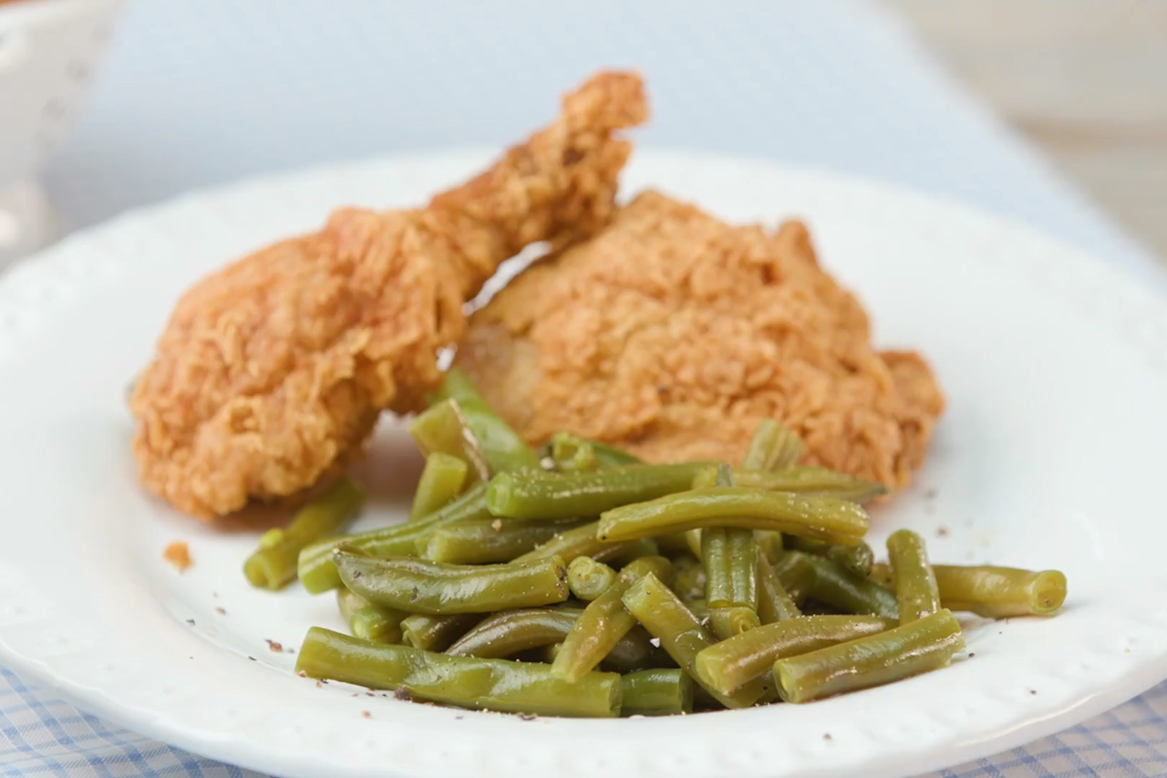 """<p><b>Recipe: </b><a href=""""https://www.southernliving.com/recipes/southern-style-green-beans-recipe""""><b>Southern-Style Green Beans</b></a></p> <p>Want the key to a <a href=""""https://www.southernliving.com/side-dishes/how-to-cook-string-beans"""">perfect pot of green beans</a>? Cook them just until tender, not mushy, and include a ham hock, pork, bacon slices, or leftover ham bone for robust Southern flavor.</p>"""