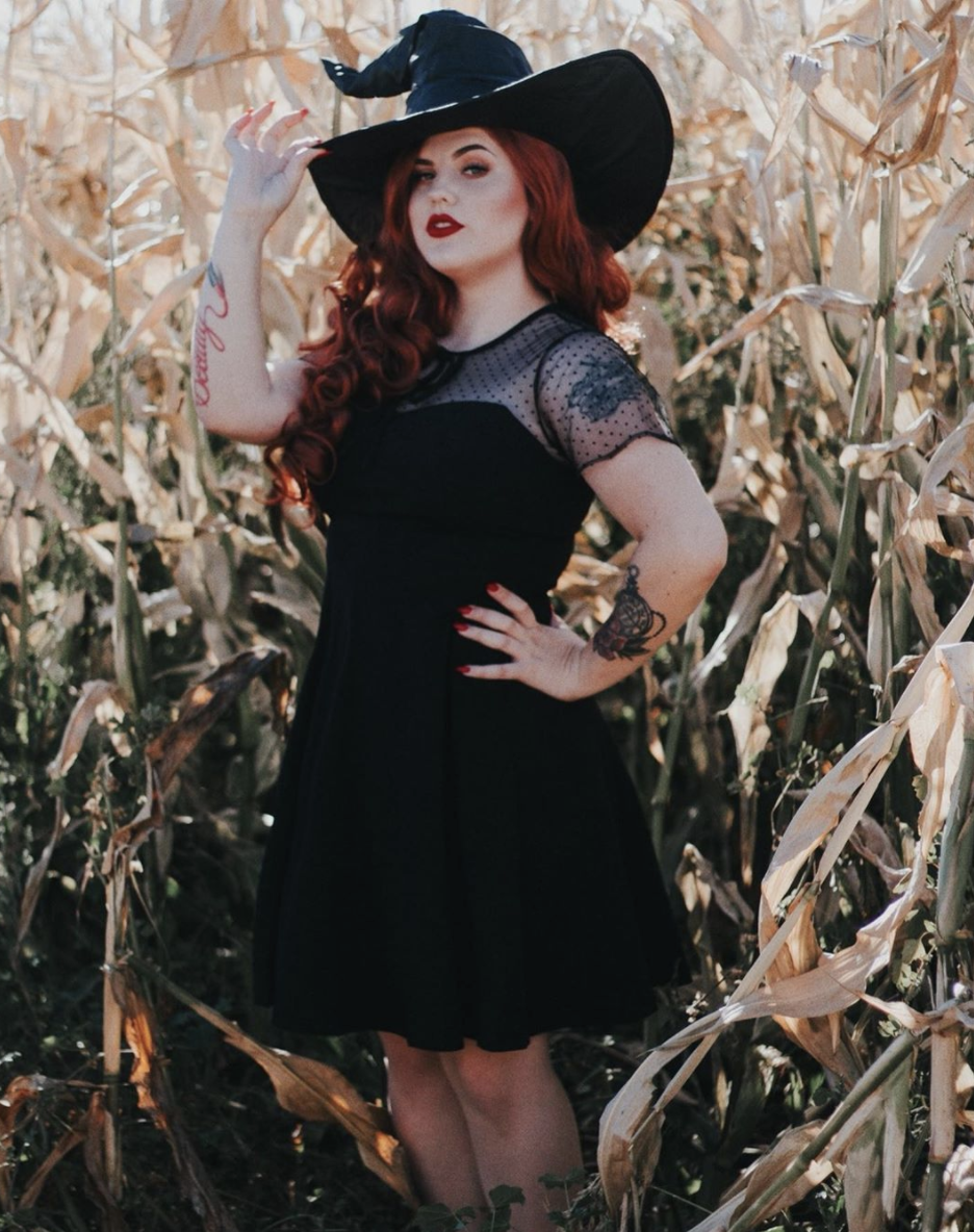 """<p>For a look that really hits, but is easy to pull together from things you already own, pair a pretty black dress with a large, ruched witch hat. </p><p><a class=""""link rapid-noclick-resp"""" href=""""https://www.amazon.com/Nemidor-Womens-Scooped-Neckline-Cocktail/dp/B074KZHTJR/?tag=syn-yahoo-20&ascsubtag=%5Bartid%7C10072.g.33534666%5Bsrc%7Cyahoo-us"""" rel=""""nofollow noopener"""" target=""""_blank"""" data-ylk=""""slk:SHOP DRESS"""">SHOP DRESS</a></p><p><a class=""""link rapid-noclick-resp"""" href=""""https://www.amazon.com/Leg-Avenue-Womens-Large-Ruched/dp/B00JSJSTK2?tag=syn-yahoo-20&ascsubtag=%5Bartid%7C10072.g.33534666%5Bsrc%7Cyahoo-us"""" rel=""""nofollow noopener"""" target=""""_blank"""" data-ylk=""""slk:SHOP HAT"""">SHOP HAT</a></p>"""