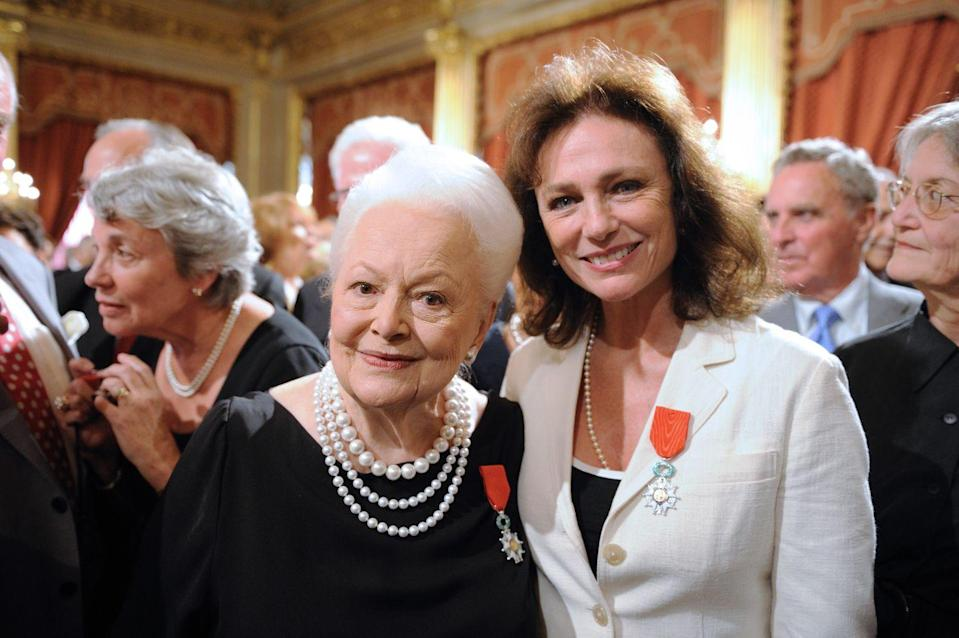 <p>Olivia posed with actress Jacqueline Bisset after they were both awarded the French Legion of Honor at the Élysée Palace in 2010. </p>
